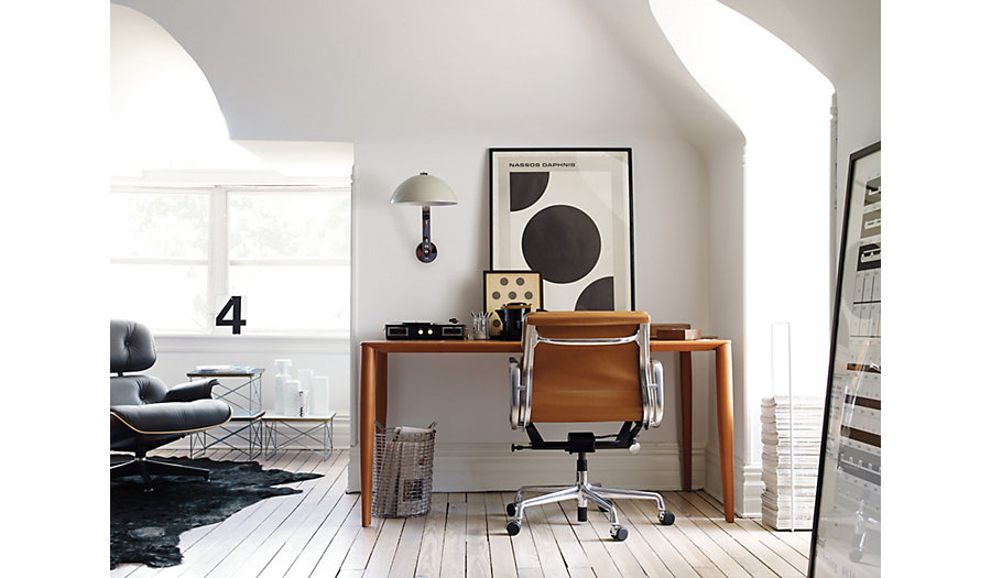 Items in this image: Bottega Leather Desk, Eames Soft Pad Management Chair, London Wall Light, Eames Lounge Chair and Ottoman, Spinneybeck Cowhide Rug, Mixrack, Eames Wire Base Low Table, Korbo Handmade Wire Basket