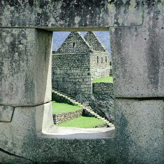 "Peru Luxury Travel: Looking through one of the windows of the ""Temple of the Three Windows"" in Machu Picchu. (Wes Walker)"