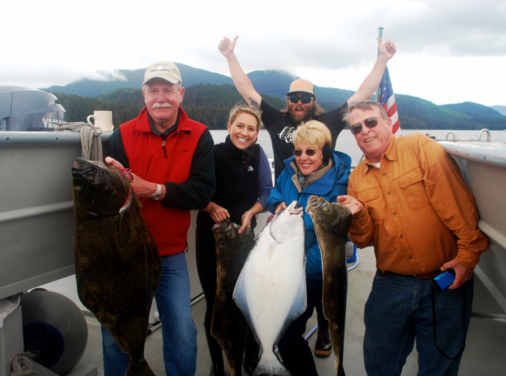 Director of Sales Lauren Frei (second from left) displays her Halibut catch and shares her first-time experience in Alaska.