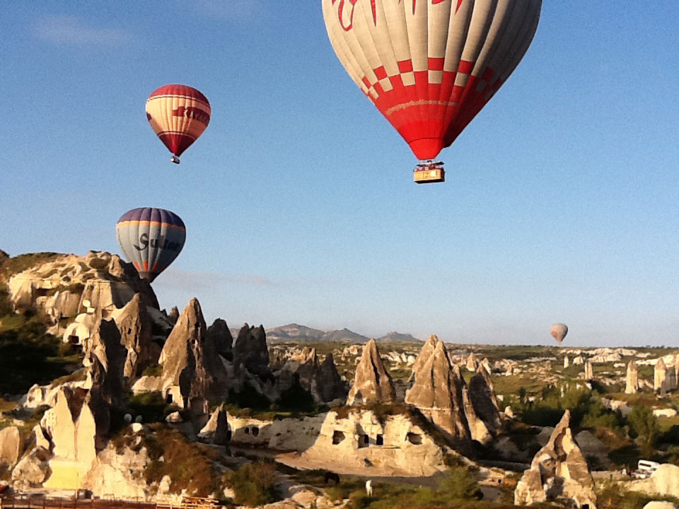 Balloons rising in the early morning light