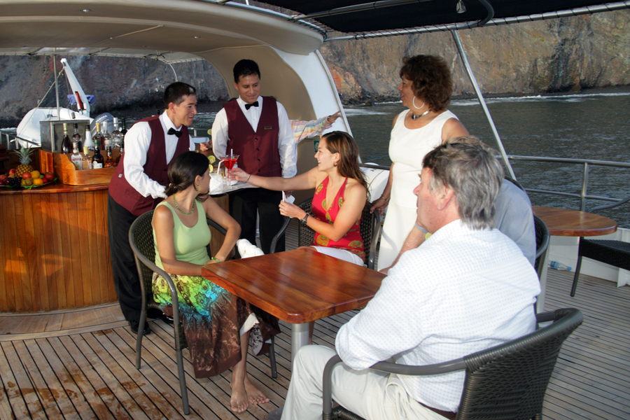 Attentive service and the casual elegance of an intimate yacht.   Photo:  INCA
