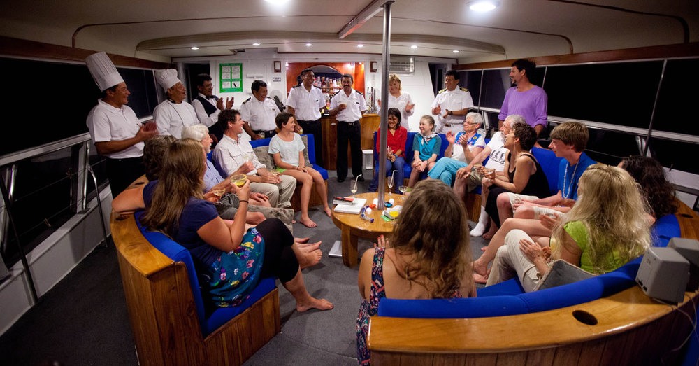 Celebrating in the Galápagos aboard Reina Silvia.  Photo © Weston Walker