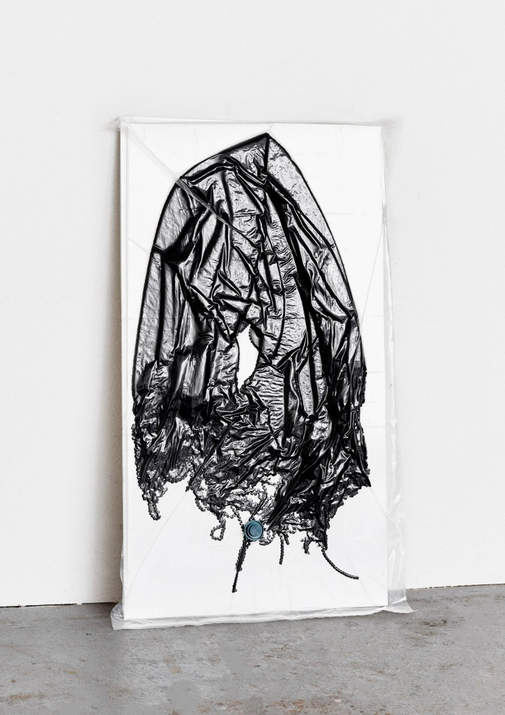 Permanent Compression, 2015  Alienating the shape of clothing by vacuum forming. Permanent Compression examines the transition between both two dimensional and three dimensional garments, while simultaneously creating a new approach of abstract painting.