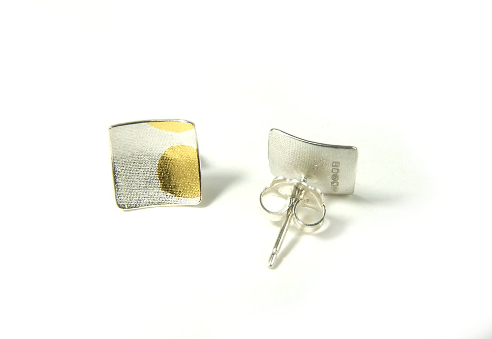 Back view of square, domed and textured Argentium silver ear studs with round Keum-Boo patterns in 22K yellow gold. Size: 10x10 mm (HBM085D)
