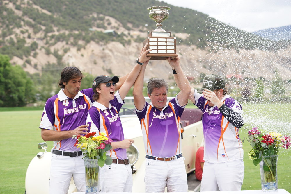 Winning Travieso teammates Nacho Novillo Astrada, Tony Calle, Teo Calle and Marc Ganzi and champagne celebration.