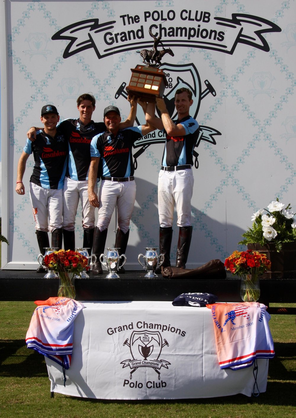 Casablanca teammates Grant Ganzi, Juancito Bollini, Mike Azzaro and Jeff Blake hoisting the coveted trophy. Photo by Sheryel Aschfort
