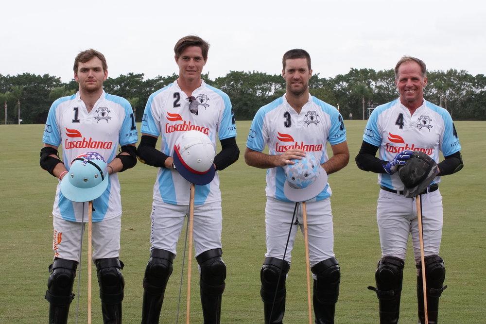 Grand Champions teammates Grant Ganzi, Juancito Bollini, Nico Pieres and Mike Azzaro.