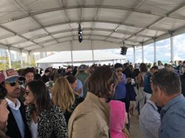 A packed crowd in the VIP tent .jpg
