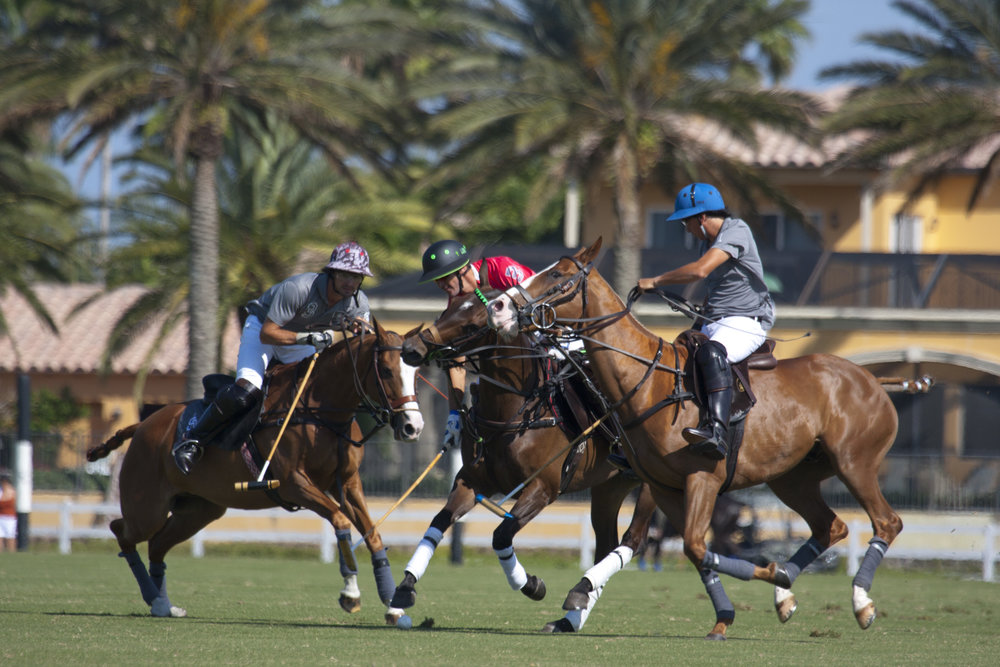 Nic Roldan of Audi is double teamed by Inaki Laprida and Peco Polledo of SD Farms.
