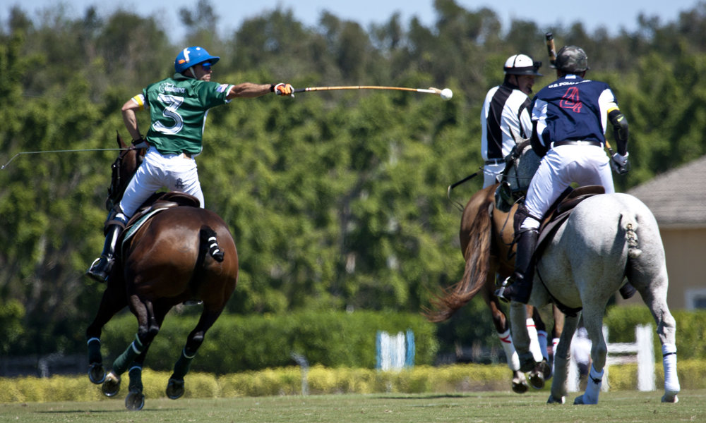 Sapo Caset of Tonkawa hits the ball out of the air with Mike Azzaro defending.Photo by Chiarofoto