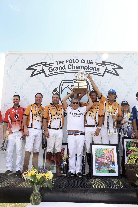 Grand Champions winning teammates Jeff Desich,MVP Rich Desich, Nacho Novillo Astrada and Nacho Figueras with Neil Hirsch. Photo by Sheryel Aschfort