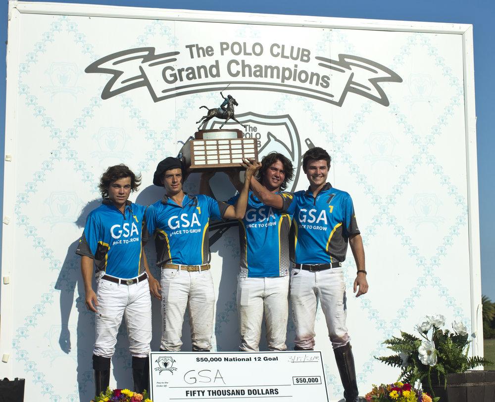 Two-time champion GSA players Toro Ruiz, Nachi Viana, Santino Magrini and Henry Porter with prestigious trophy and winner's check.