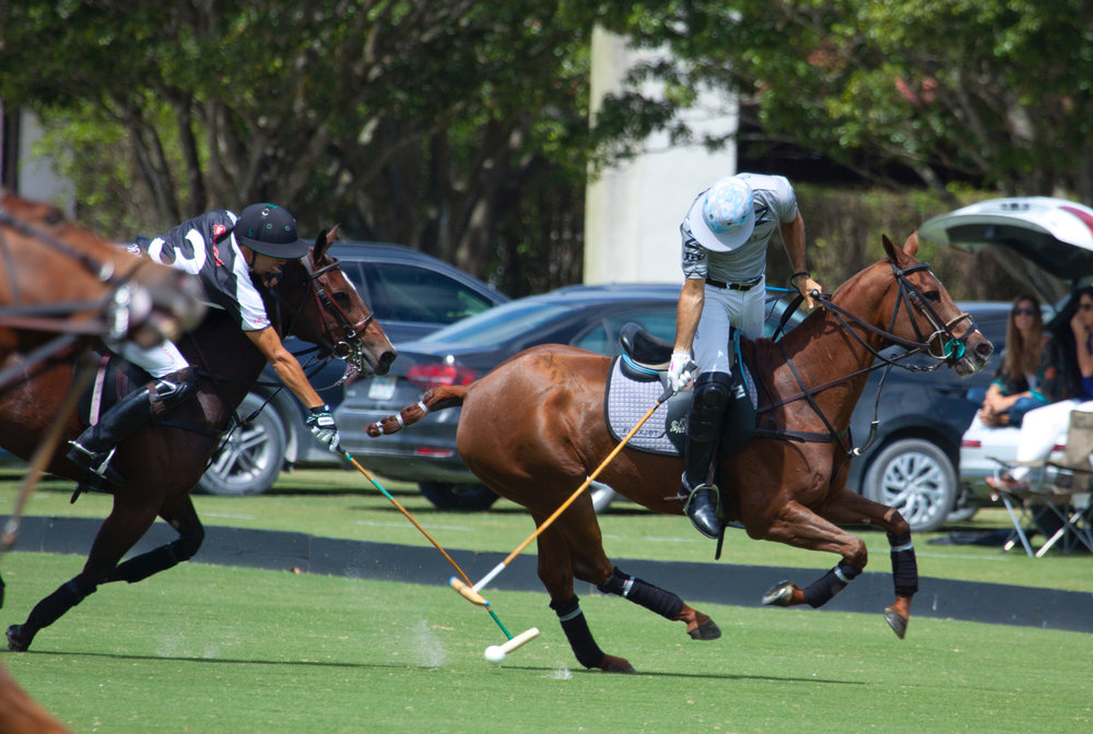 Nico Pieres of Flexjet out of the saddle to hit.JPG