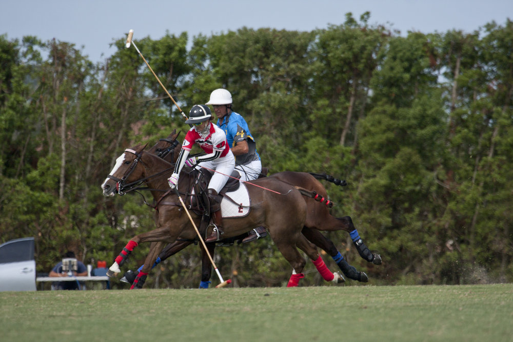 Dawn Jones of Flexjet working the near side shot to goal with Matias Magrini of GSA defending.