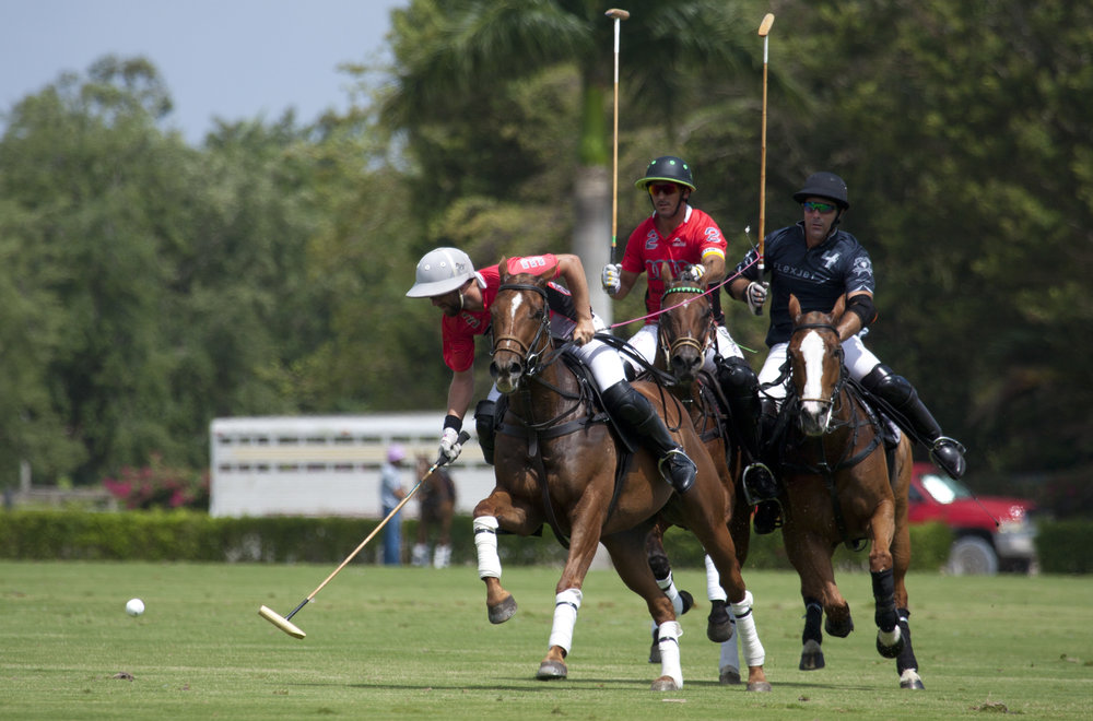 Polito Pieres of Audi works the ball dow.JPG