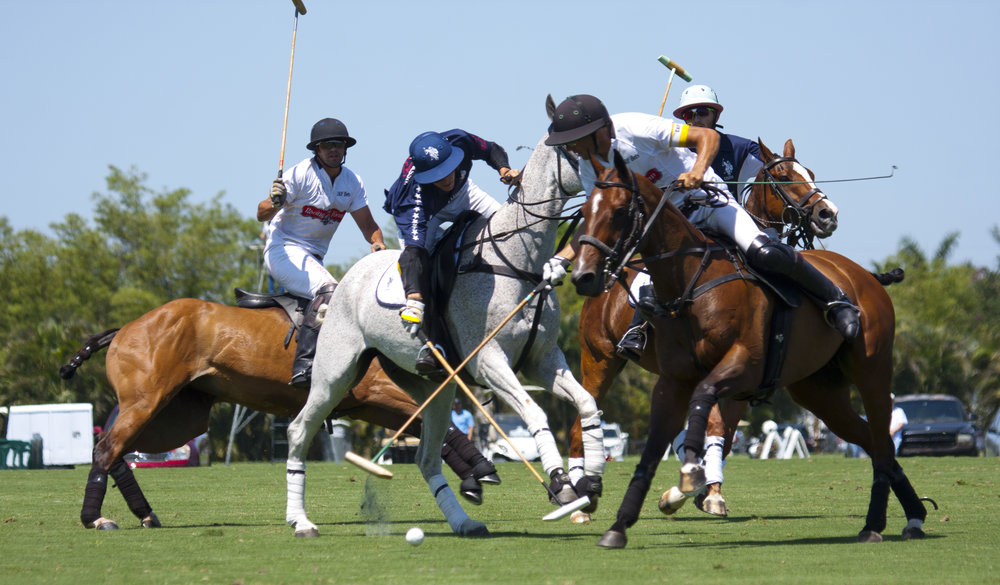 Juancito Bollini of U.S. Polo Assn. battles Hilario Ulloa of Daily Racing Form for the ball.