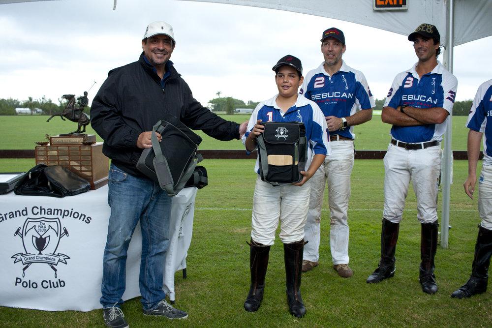 Josh Dubarry of Sebucan receiving his polo sw.JPG