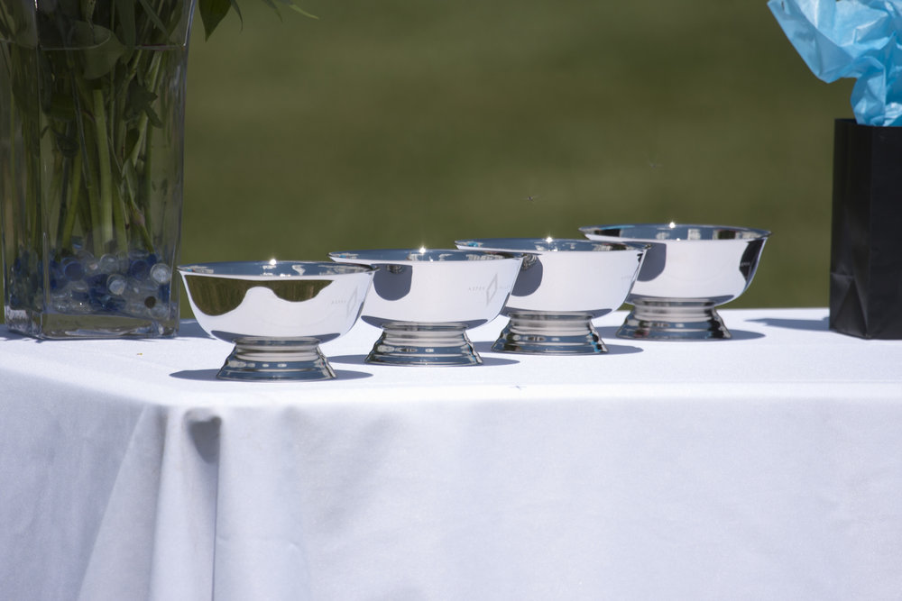Glistening bowls on the trophy table for Mountain Cup champions Los Amigos Green.
