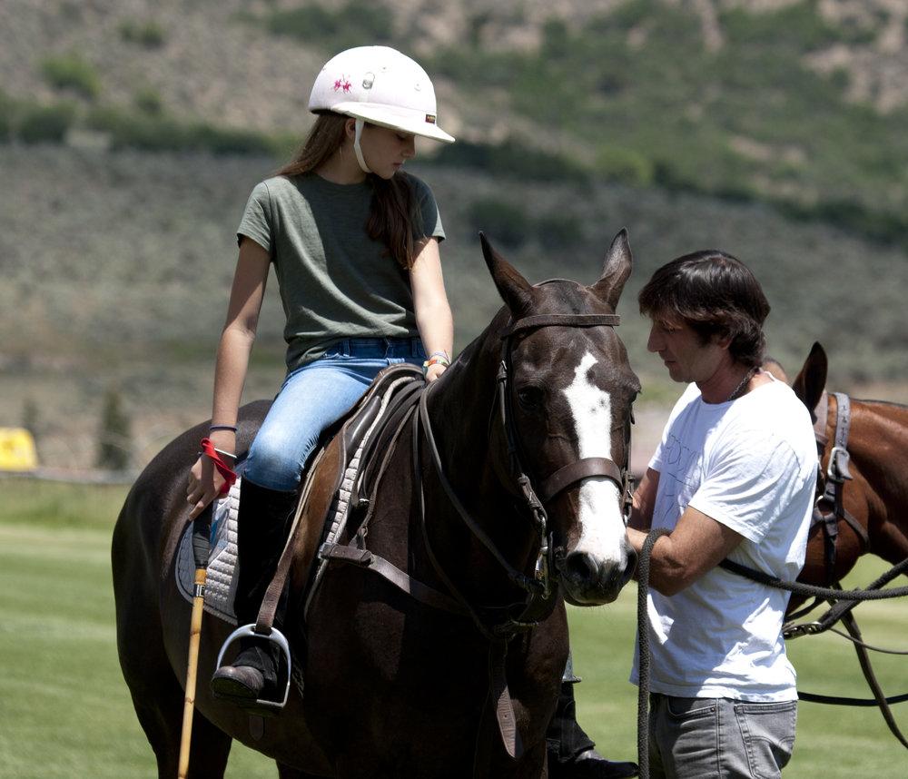 Nacho Novillo Astrada helps his daughter Mar.JPG