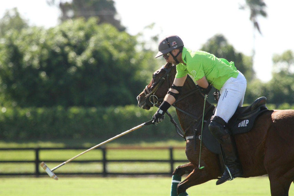 Brandon Phillips of ChukkerTV works the nearside shot on his way to scoring one of his team-high six goals.