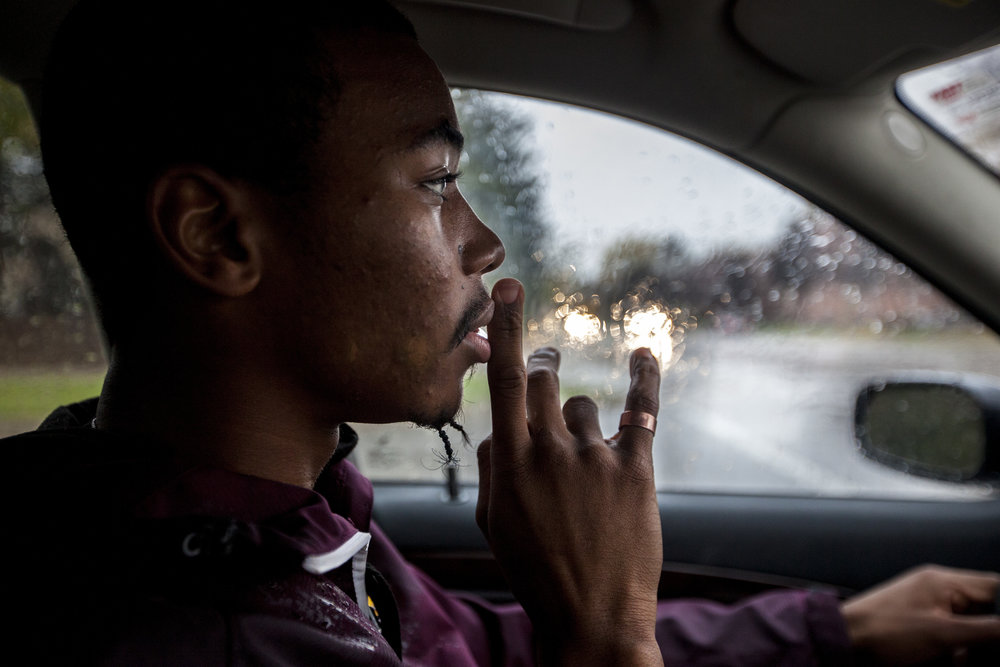 """Aaron Johnson of Brighton, Mich., ponders as he drives back to his apartment following class at Central Michigan University in Mt. Pleasant, Mich. As a musician and rapper, Johnson uses his platform of music to make a difference. """"I have a responsibility to speak up on this… (but) there's a lot of grace that has to be involved,"""" says Johnson."""