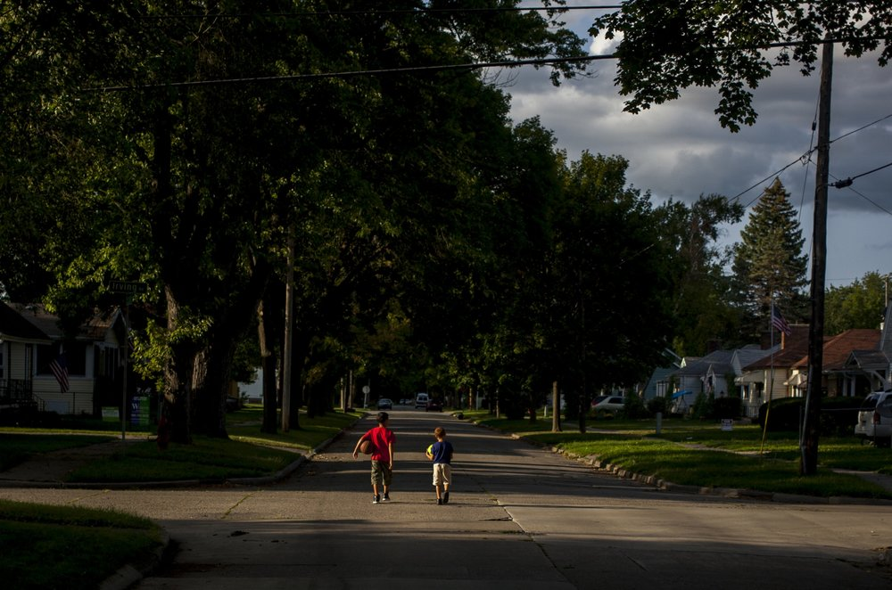 A pair of young men walk home after a game of basketball with friends on Saginaw's Westside.
