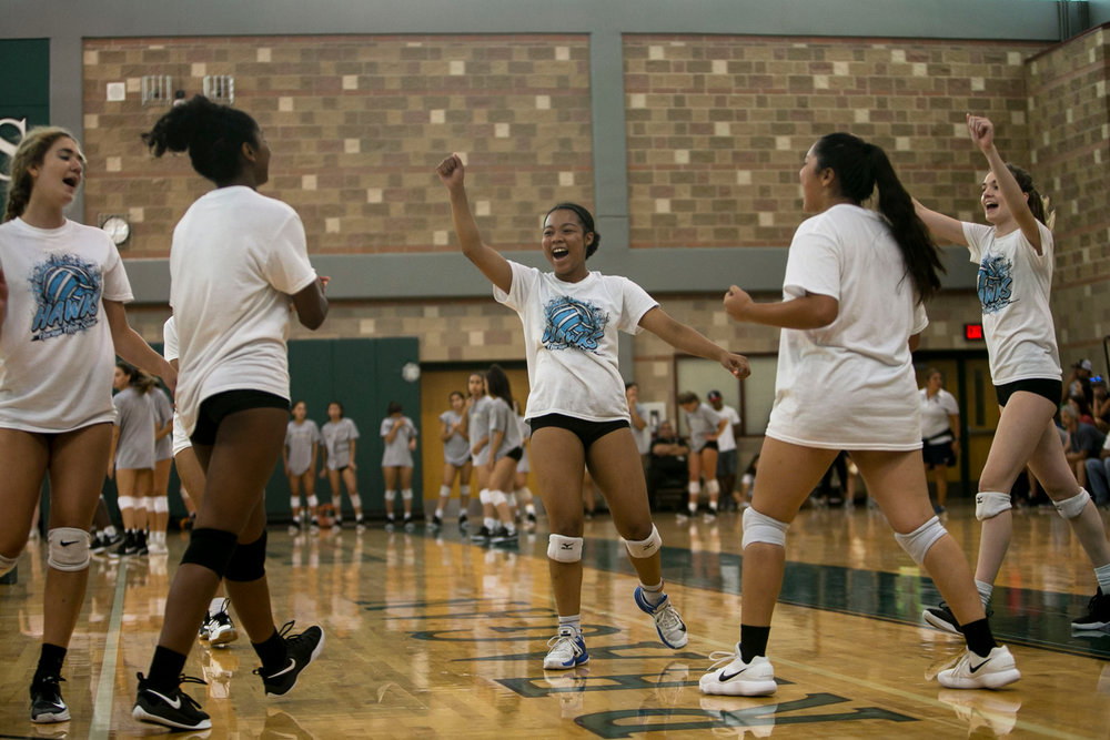 Jevani Hanspard, 16, leads a cheer following the team scoring a point during a scrimmage held at Reagan High School.