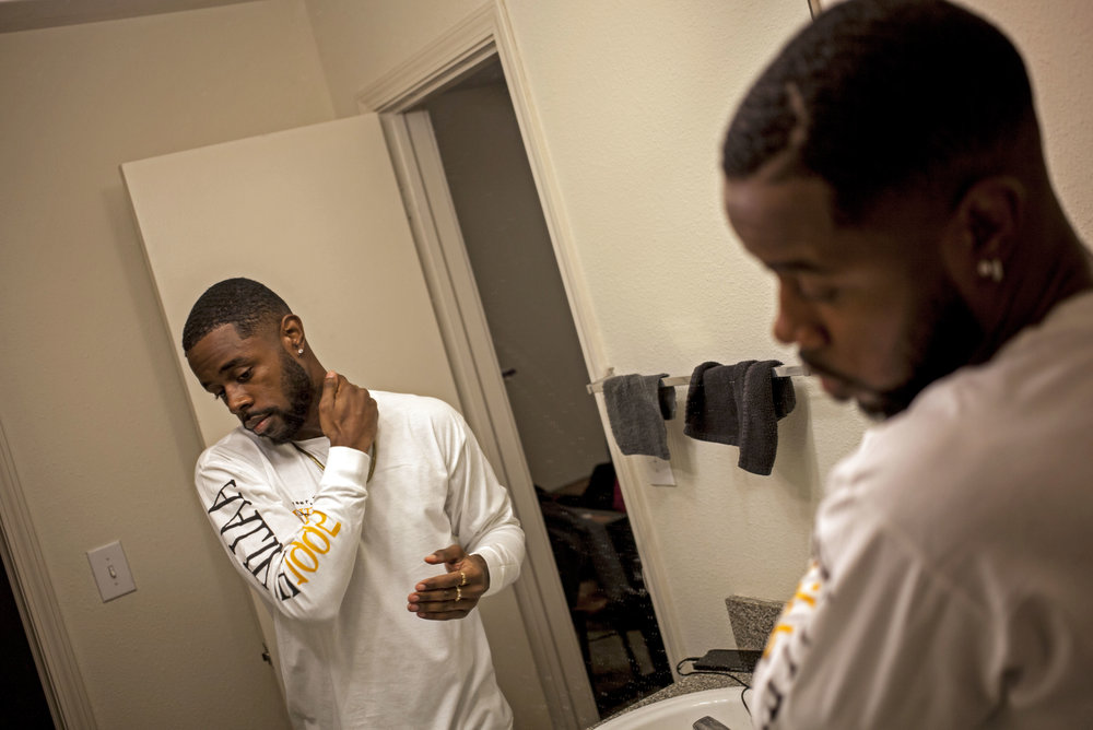 Deontè Gardner takes a moment as he gets ready for his final headlining show as Cassius Tae in Mt. Pleasant, Mich., before his graduation from Central Michigan University.
