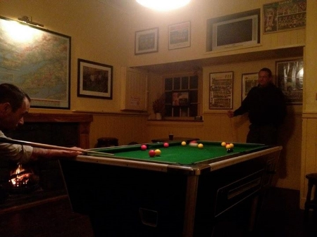 Getting schooled in pool by our local friend
