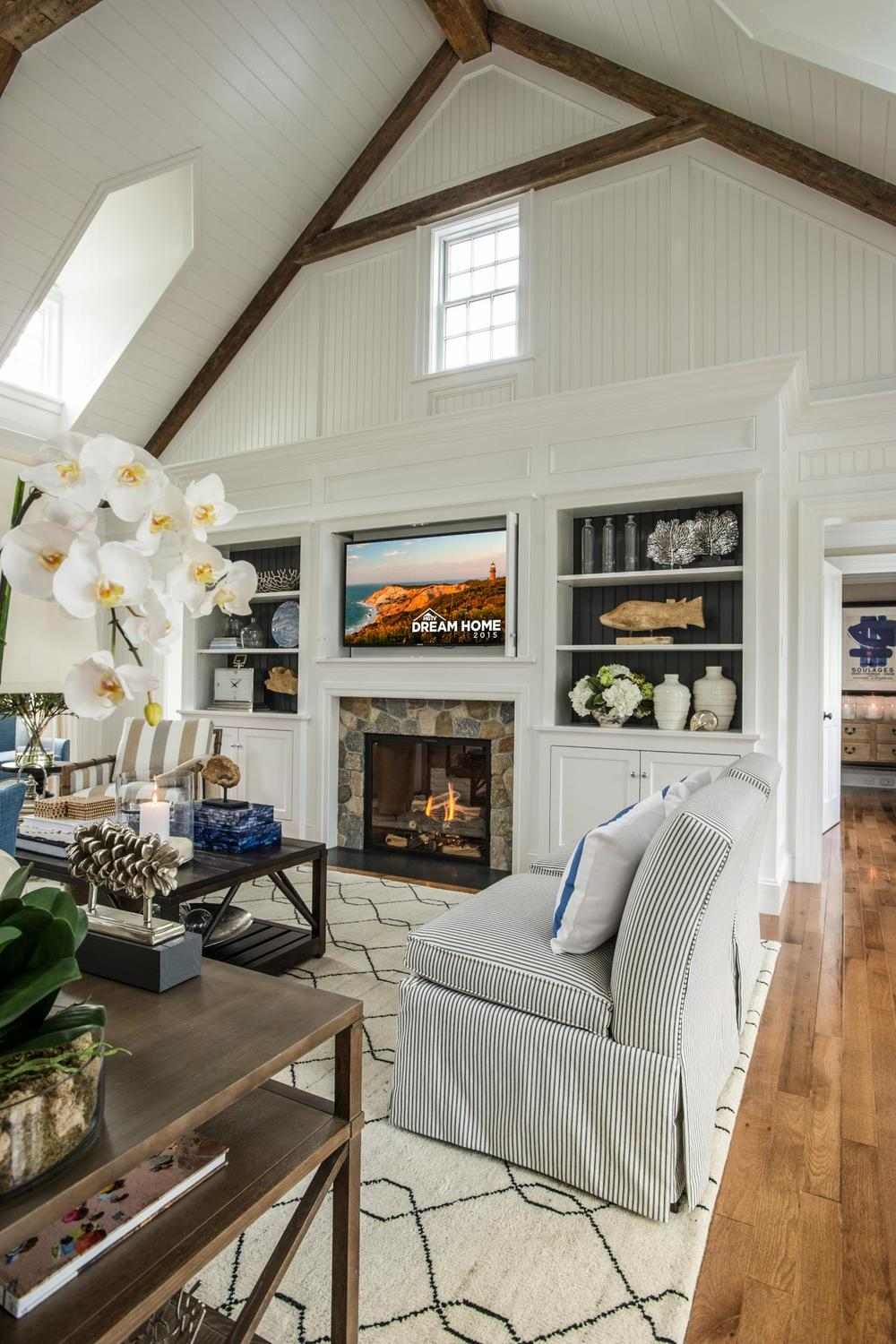 dh2015_great-room_built-in-bookcases-stone-fireplace_v.jpg.rend.hgtvcom.1280.1920.jpeg