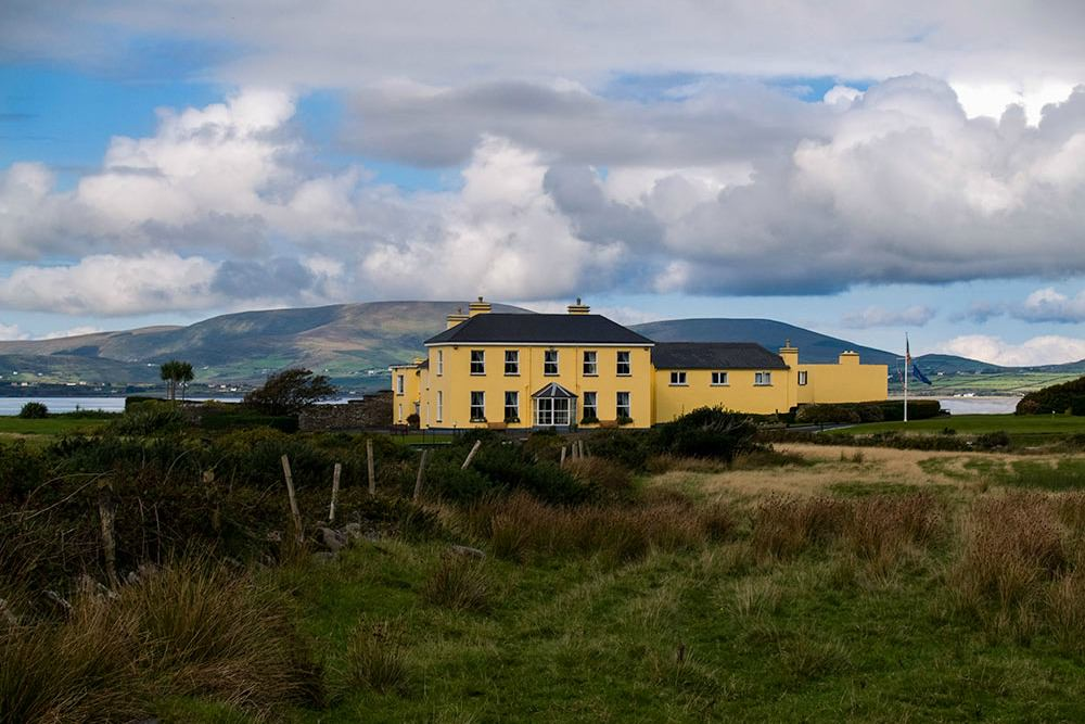 The Georgian Manor sits on a narrow isthmus facing the wild Atlantic with beautiful Lough Currane on its eastern perimeter.   Waterville House