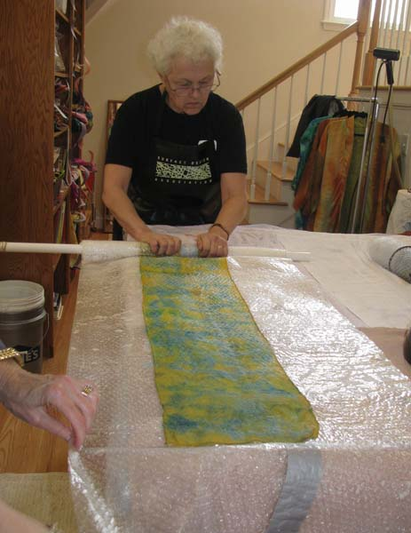 Rolling felted silk and bubble wrap into a tube