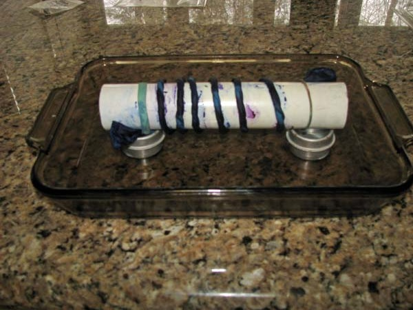 preparation for microwave silk steaming: pole wrapped scarf in dish