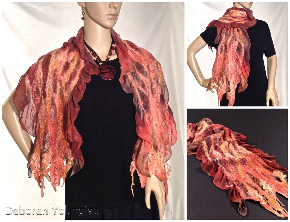 N029 - approx. 15 x 60 in. Silk chiffon, wool roving, and other fibers. Beaded along edges  Copper, peach, brown