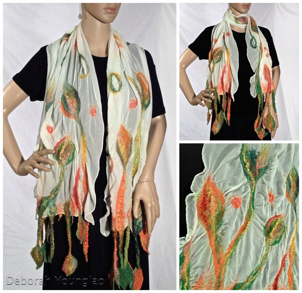 N042 - approx. 15 x 72 in. (without fringe). Silk chiffon, wool roving, and other fibers.  Green, orange, rust, tan, gold