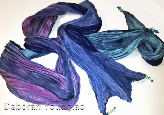 Pleated, pole-wrapped, indigo dyed silk scarf