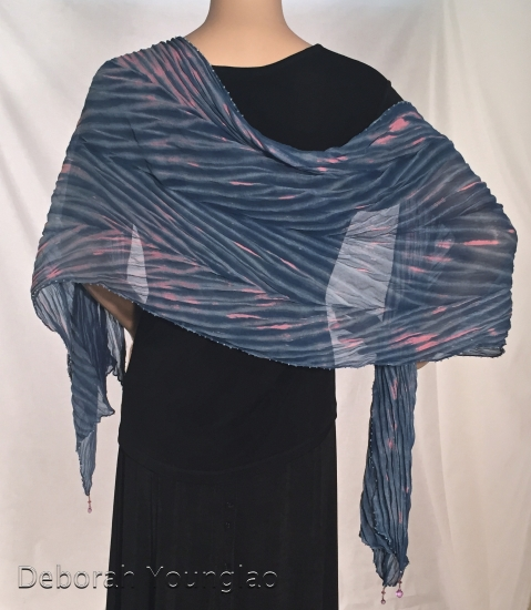 Pleated shibori silk chiffon shawl with beaded edges and tips. Pleated size approx 15 x 66 in, original size 22 x 80 in.