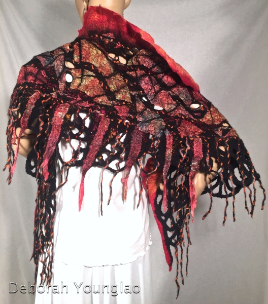 Nuno felted shawl, mosaic design. Merino wool, hand dyed silk fabrics, sari silk threads, wool/nylon yarn.