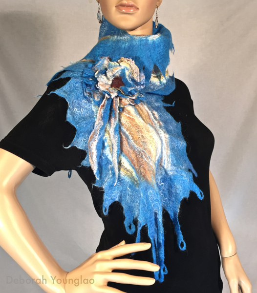 Felted scarf and felted brooch. Merino wool, silk fibers.
