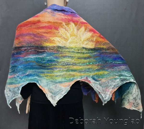 Felted shawl, sunset. Merino wool, silk fiber, firestar nylon fiber, sari silk threads, silk hankies.