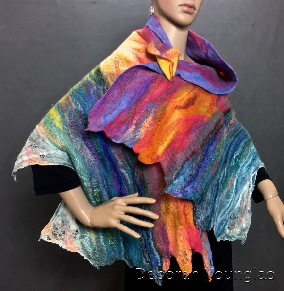 Felted shawl, sunset. Merino wool, silk fiber, firestar nylon fiber, sari silk threads, silk hankies. Includes a felted brooch for closure.