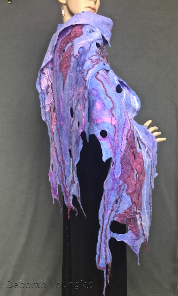My favorite! The base merino wool of this shawl is such a beautiful periwinkle blue. I embellished it with purple, pink and burgundy silk fabric, silk fibers and different types of yarn. Although there's a lot going on in this piece, it's very thin, light and flexible.
