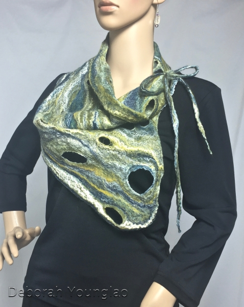 Another asymmetrical collar scarf with holes and dreads for tying. Merino wool and silk fibers.