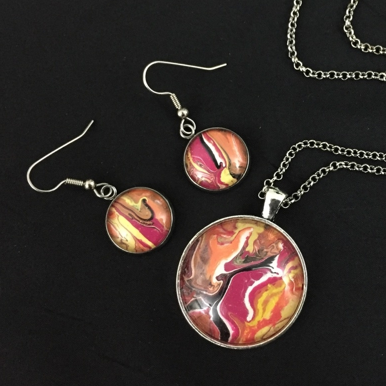 Hand painted acrylic pendant and earrings