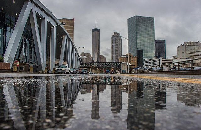 Well, all it took was us issuing a rain challenge for the sun to come out! But rain is still in the forecast for the weekend, so keep on showing our city's wetter side. Take inspiration from#weloveatl contributor  @thegreatkingace, whose feed is filled with masterful puddle reflections of Atlanta. Pro tip: turn your phone upside down (and if it's not waterproof hang on tight!) to put the lens as close to the puddle as possible to get the most balanced reflection possible.
