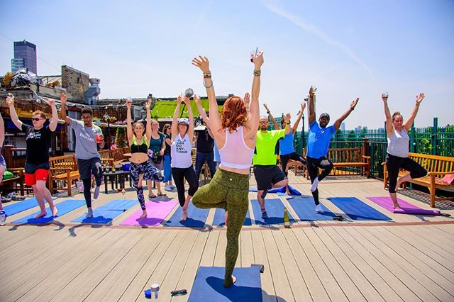 """Hands up if you love yoga and wine! 🙌🧘♀️🍷 . Excited to announce our newest collaboration with @rooftopcrawl on July 14th on the rooftop of the beautiful @monarchnyc ✨ ...Biggest Drunk Yoga event yet! Class led by founder @eliwalkernyc ☝️ . To RSVP, www.dodrunkyoga.com and click on """"Events."""" 🥂 . See you there! ⠀ .⠀ .⠀ .⠀ .⠀ ⠀ #drunkyoga #dodrunkyoga #drunkyogacommunity #motivationalquotes #inspiration #motivational #yogaclass #instagood #goodvibes #goodvibesonly #drunkyogagirl #yoga #yogateacher #youareenough #empoweredwoman #wine #cheers #winelover #wineoclock #winetime #wineyoga #yogaeverydamnday #drunkyogaeverydamnday #namaste #namasteresponsibly #namacheers #drunkyogaclass #blessed"""