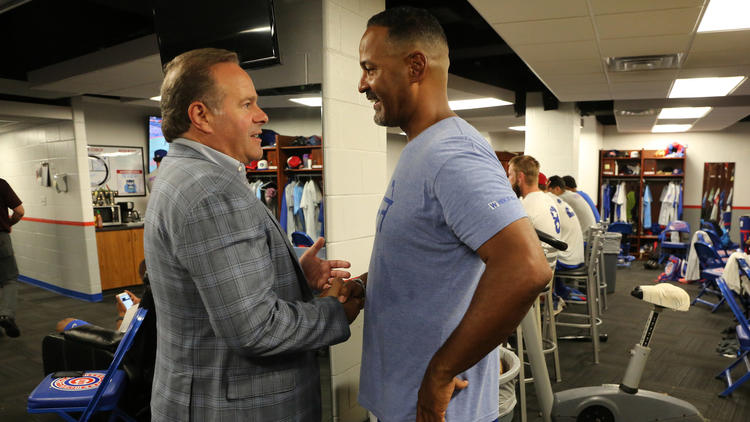 South Bend Cubs owner Andrew Berlin greets manager Jimmy Gonzalez, in the team clubhouse as he makes his rounds at Four Winds Field on Thursday, Aug. 25, 2016.  (Antonio Perez / Chicago Tribune)