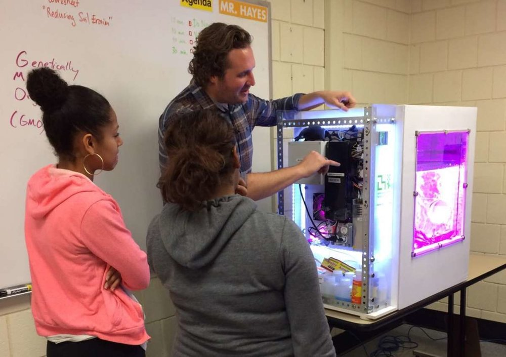 Caleb Harper with school children and the Personal Food Computer
