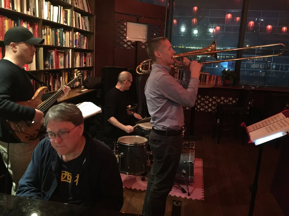 The Ah Q Jazz Arkestra performing at the Beijing Bookworm in March 2017. Matt Roberts on trombone, and David Moser (foreground) on keyboards.