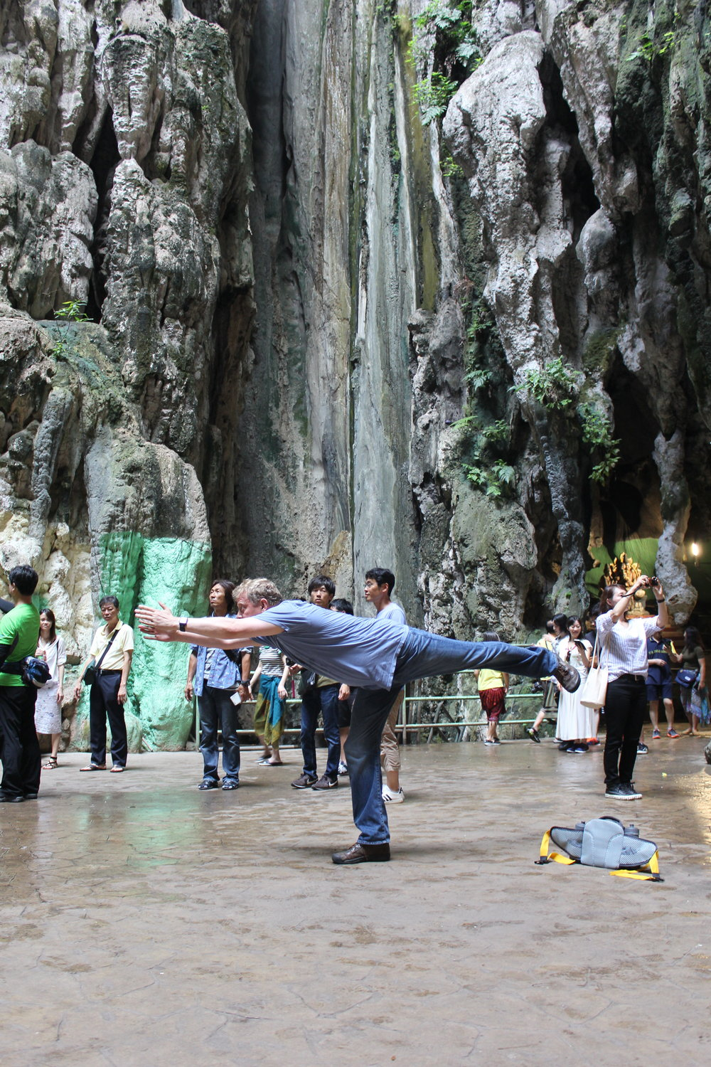 Practicing my yoga, and my levitation skills, in the Batu Caves